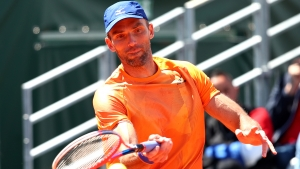 Karlovic bows out, Tomic's struggles continue