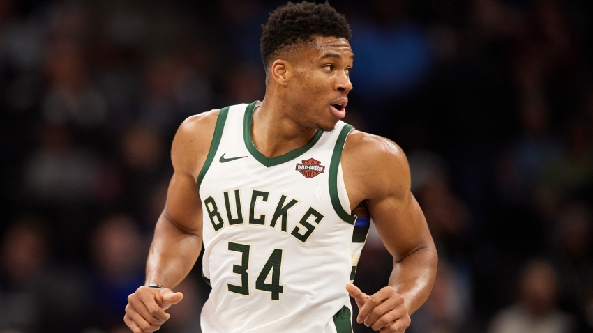 Giannis lifts Bucks past Celtics, Ingram's 49 helps snap Jazz's 10-game winning streak