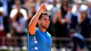 Thiem sets up home final against form man Ramos-Vinolas