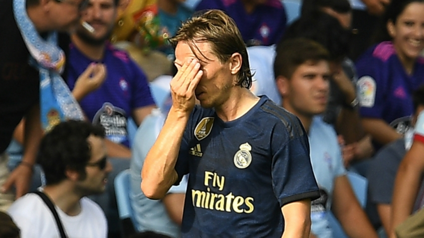 Modric denies deliberately stamping on Suarez