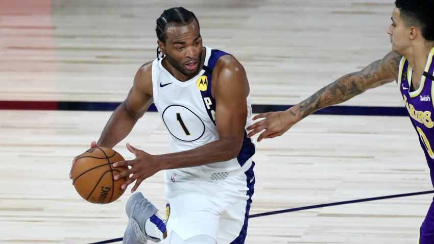Warren outshines LeBron's Lakers, Doncic wins Giannis duel