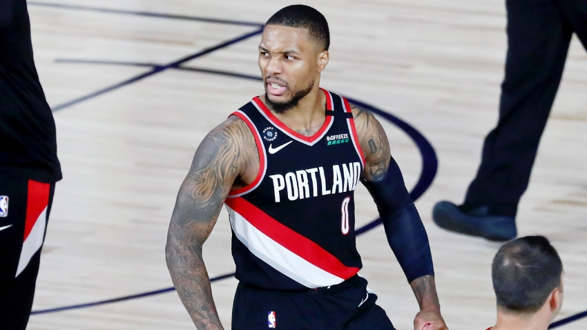 Lillard honoured to join Chamberlain after 61-point performance