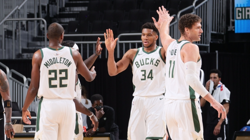 Giannis leads Bucks into playoffs with Nets win, Curry breaks more records
