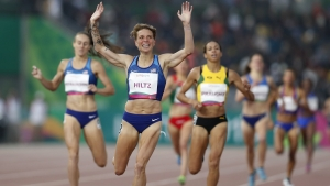 Dominique Hiltz of the United States wins the gold medal in the women's 1500m during the athletics at the Pan American Games in Lima, Peru, Friday, Aug. 9, 2019.
