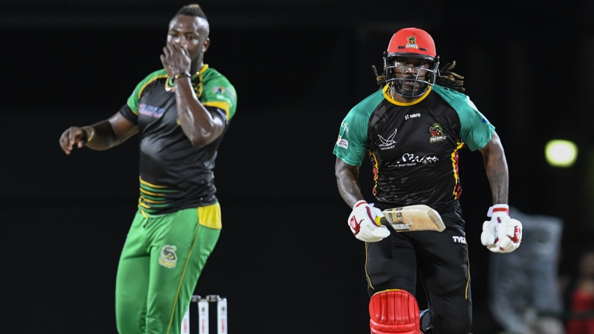Jamaica Tallawahs skipper Andre Russell (left) and his opposite number from the St Kitts and Nevis Patriots, Chris Gayle.