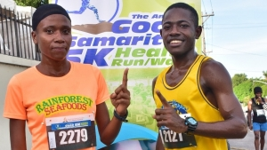 Good Samaritan 5k winners Areita Martin (Rainforest Seafoods) and Henry Thomas (UCT Steppas) pose after claiming top spot.
