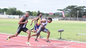 Asafa Powell (left) of MVP Track Club gets the better of Sprintec Lions' Andrew Fisher to win section one of the men's 60m at the 42nd edition of the Milo Western Relays at GC Foster College on Saturday, February 8, 2020.