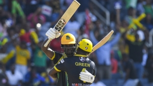 Chadwich Walton celebrates with Derval Green following the team's win over Barbados Tridents.