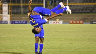 Clarendon College's Omar Reid reacts with a somersault after scoring the second goal of the game during their Round of 16 match against Wolmer's Boys in the 2019 ISSA all-island Champions Cup on Friday, November 1 at the National Stadium.