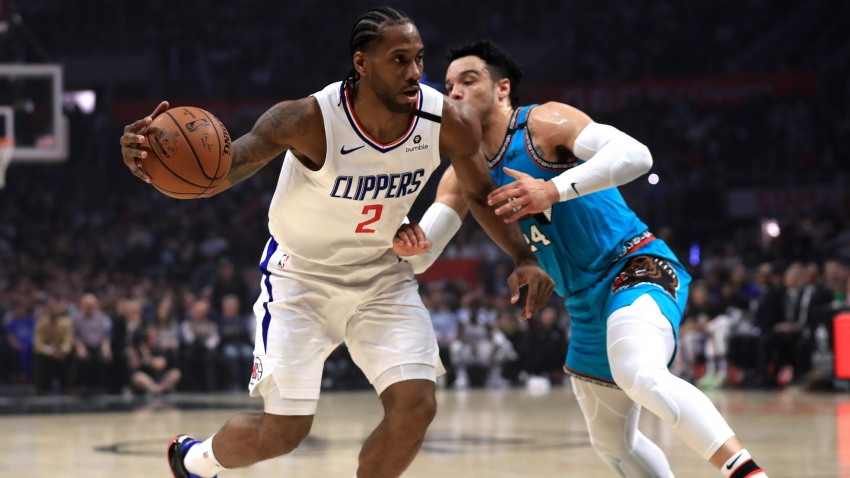 Clippers end losing streak as Embiid, Beal star