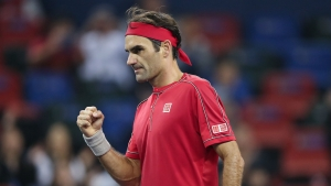 Federer flies through to set up possible Wawrinka clash