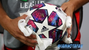 A match official cleans the ball ahead of the Champions League round of 16 second leg soccer match between Bayern Munich and Chelsea at Allianz Arena in Munich, Germany, Saturday, Aug. 8, 2020.