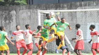 St Jago High's defenders challenge for an aerial ball against Mona High during their ISSA/Digicel Walker Cup first round fixture at Prison Oval in Spanish Town on Friday, November 8, 2019. Mona won 2-0.