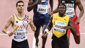 Javon Francis, foreground right, of Jamaica and Kevin Borlee, left, of Belgium, cross the finish line in their men's 4x400 meter relay heats during the World Athletics Championships in Doha, Qatar, Saturday, Oct. 5, 2019.