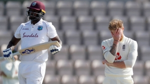 England captain Ben Stokes, right, reacts after West Indies captain Jason Holder, left, hit a boundary off one of his deliveries during the fifth day of the first cricket Test match between England and West Indies, at the Ageas Bowl in Southampton, England, Sunday, July 12, 2020.