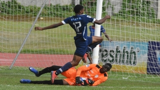 Hydel High's goalkeeper Shaquan Davis pulls off a save as Jamaica College's Shaniel Thomas jumps out of the way during their second-round return leg fixture of the ISSA/Digicel Manning Cup football competition at the Stadium East field on Saturday, October 26, 2019.