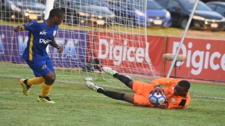 Jonathan Grant High's goalkeeper Jordan Taylor makes a save during their second-round first-leg fixture of the 2019 ISSA/Digicel Manning Cup football competition against Excelsior High at the Stadium East field on Thursday, October 24, 2019.