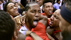 Toronto Raptors forward Kawhi Leonard, center, celebrates his game-winning basket as time expired at the end of an NBA Eastern Conference semifinal basketball game against the Philadelphia 76ers, in Toronto on Sunday, May 12, 2019. Toronto won 92-90.
