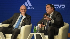FIFA President, Gianni Infantino and Victor Montagliani, CONCACAF President, speak during the 11th Dubai International Sports Conference on December 28, 2016 in Dubai, United Arab Emirates.