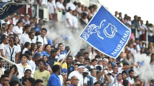 Naparima College fans in a celebratory mood.