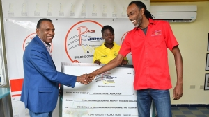 Smiles all around, JCA President Wilford 'Billy' Heaven and Maurice Broadbell, Operations Supervisor at Pace Electrical Works shake hands during the press conference to announce Pace Electrical Works as a sponsor of the national women's cricket programme at Sabina Park on Wednesday afternoon. Sharing in the moment is Rashada Williams of the Senior Women's Cricket team.