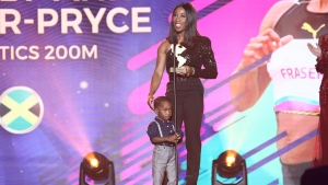 Shelly-Ann Fraser-Pryce during her acceptance speech at the inaugural Panam Sports Awards in Fort Lauderdale on Friday. Fraser-Pryce was onstage with son Zion.
