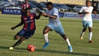 Romario Campbell of St Andrew Technical High School (STATHS) dribbles away from a St George's College defender during their Group H quarter-final round match in the 2019 ISSA/Digicel Manning Cup football competition on Wednesday, November 6. STATHS won 3-1.