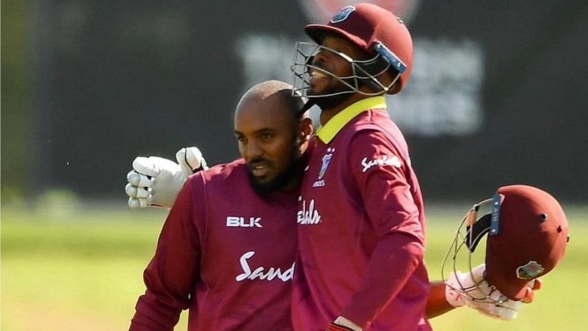 Sunil Ambris of West Indies, left, is congratulated by team-mate Roston Chase after scoring a century during the One Day International match between Ireland and West Indies at Malahide Cricket Ground, Malahide, Dublin.