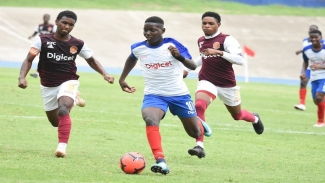 Shaqueil Bradford (right) of Camperdown High dribbles away from Shamour McLean of Wolmer's Boys during their opening Group A quarter-final match of the 2019 ISSA/Digicel Manning Cup football competition at the National Stadium on Wednesday, October 30. Wolmer's won 3-2.